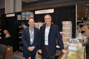 Canadian dealers Chris, left, and Vance Carmichael of Vance Auctions at their booth.
