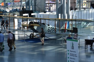 A restored, 100-year-old Curtiss JN-4H, dubbed the Jenny, is on display near the entry area of the World Stamp Show.